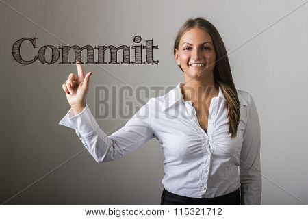 Commit  - Beautiful Girl Touching Text On Transparent Surface