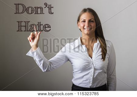 Don't Hate - Beautiful Girl Touching Text On Transparent Surface