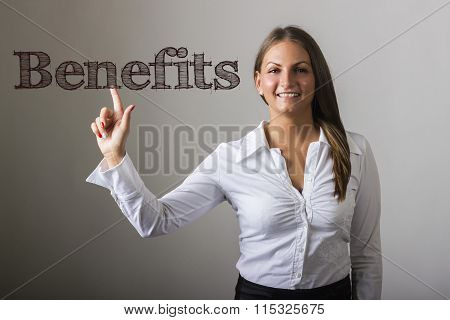 Benefits - Beautiful Girl Touching Text On Transparent Surface