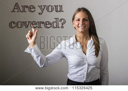 Are You Covered? - Beautiful Girl Touching Text On Transparent Surface