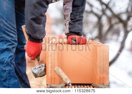 Detail Of Worker, Bricklayer Construction Engineer Fixing Bricks And Building Walls At New House On
