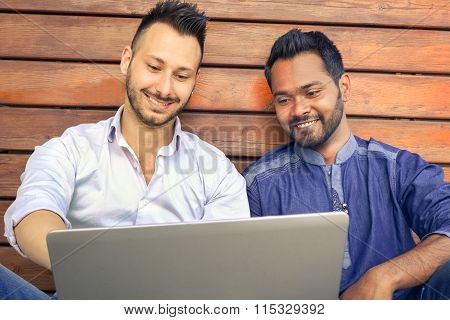 Happy Hipster Guys Using Modern Laptop Computer - Smiling Male Models With Pc Device