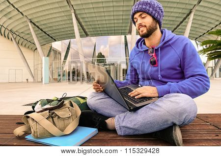 Businessman With Pc Sitting Outdoor - Attractive Guy Smiling Using Laptop Online -