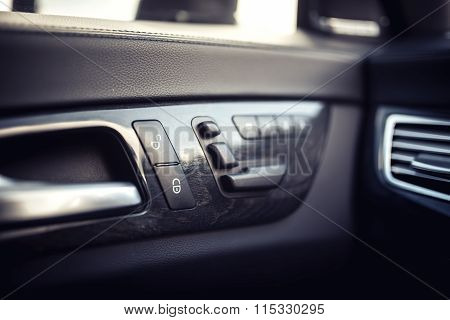 Car Leather Interior Details Of Door Handle With Windows Controls, Seat Adjustments. Modern Windows