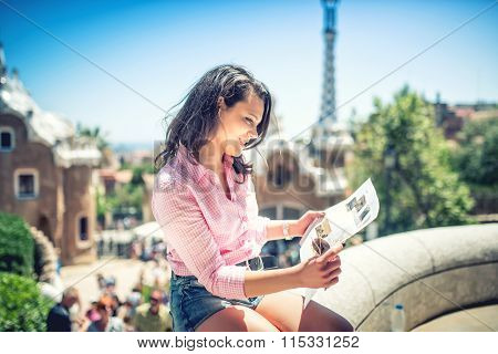 Pretty Attractive Girl Studying Map While Traveling On A Sunny Day. Travel Concept