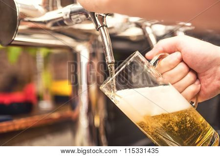 Bistro Waiter Serving A Cold, Chill Beer. Hand Of Barman Pouring A Lager Beer From Tap