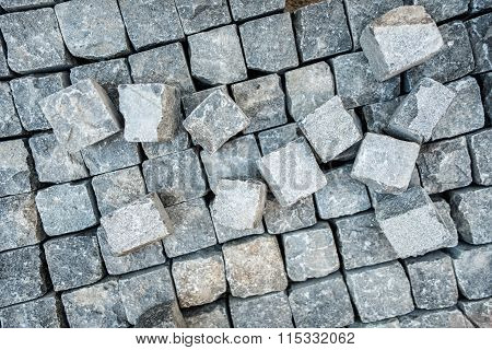 Road Pavement, Stone Blocks And Construction Tools. Construction Worker Laying Cobblestone Pavement