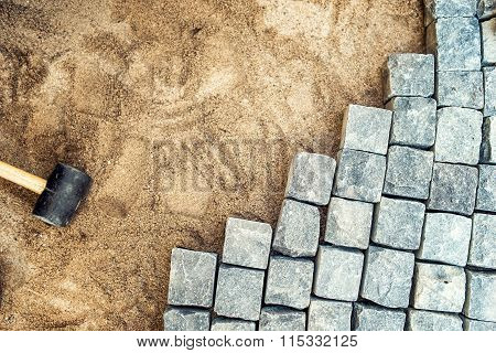 Construction Tools And Details, Pavement Installing And Rocks. Granite Stones Laying On Sand