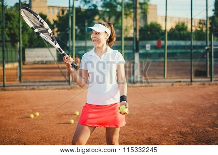 Young Tennis Player, Sportswoman On Clay Court With Racquet And Balls. Lifestyle With Sport And Prac