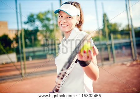 Portrait Of Woman Playing Tennis, Holding Racket And Ball. Attractive Brunette Girl Wearing White T-