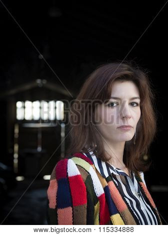 Sad woman in a bright knit sweater. Street Photography