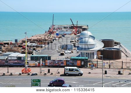 HASTINGS, ENGLAND - JULY 7, 2015: Re-construction work is carried out on the Victorian pier. Built in 1872, the pier was badly damaged by fire in October 2010 and is expected to re-open in March 2016.