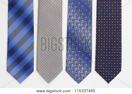 Group of colorful neckties on white