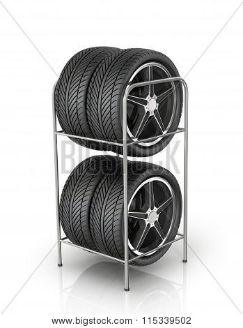 Four Automobile Wheels At The Front On A White Background.