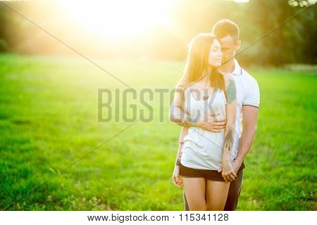 Beautiful Young Loving Couple Hugging In Nature. The Concept Of Good Mood
