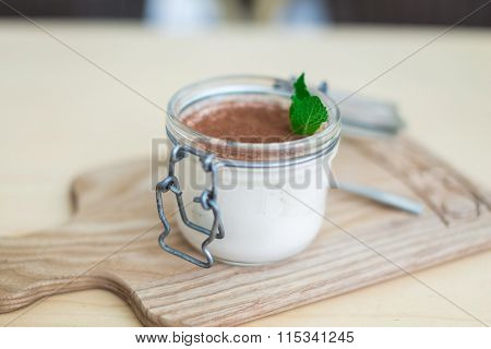 Dessert With Fruits, Nuts And Cream Cheese In Glass Jar On Wooden Background