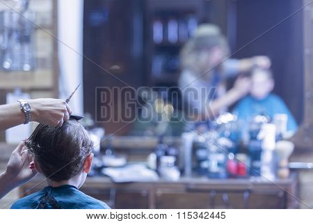 Back View Of Boy In Barber Chair