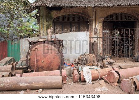Rusty Machine Parts On The Street In Myanmar