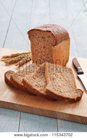Loaf Of Bread With Sliced Pieces Of Bread
