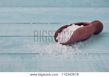 Sea Salt In Scoop On A Wooden Background