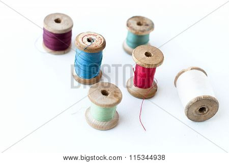 Spool of thread . Sew accessories Multi-colored threads for sewing