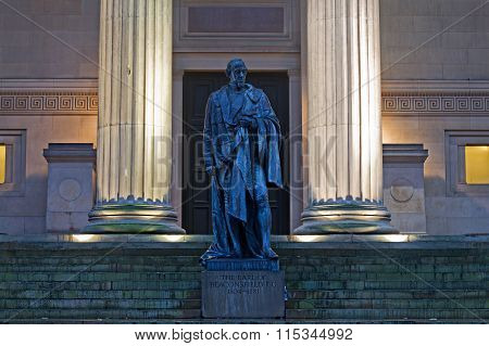 Statue on steps of St Georges Hall Liverpool UK