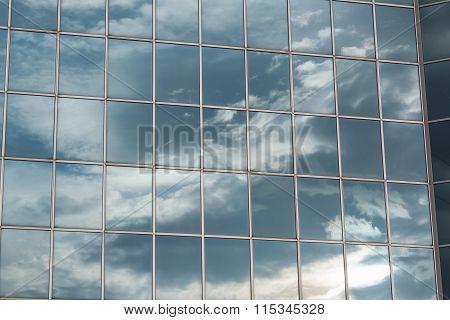 Modern Building Glass Facade Reflecting Cloudy Blue Sky