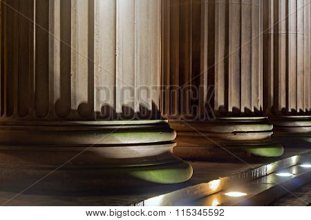 Sandstone columns lit up at night time