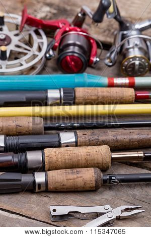 Fishing Rods And Reels On Wooden Boards