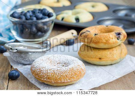 Freshly Baked Doughnuts With Blueberries For Breakfast