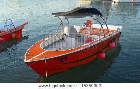 Moored pleasure boat orange