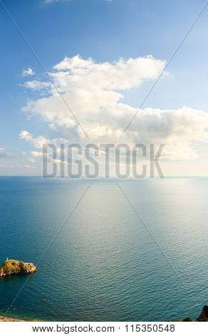 Blue Sky With Clouds Over Sea.