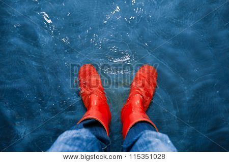 red rubber boots in the water