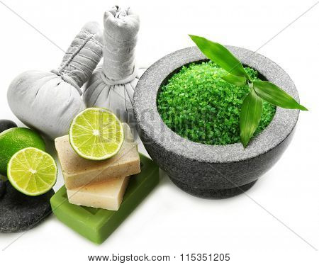 Spa composition with soap, sea salt, pebbles and lime isolated on white