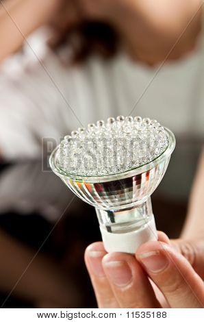 Led Lightbulb In Hand