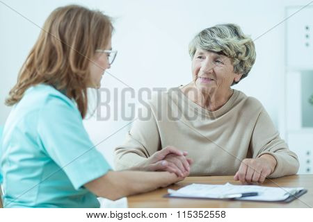 Doctor Supporting A Patient
