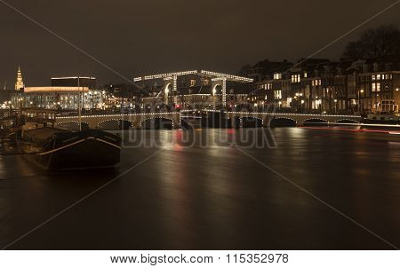 Famous bridge by night in Amsterdam