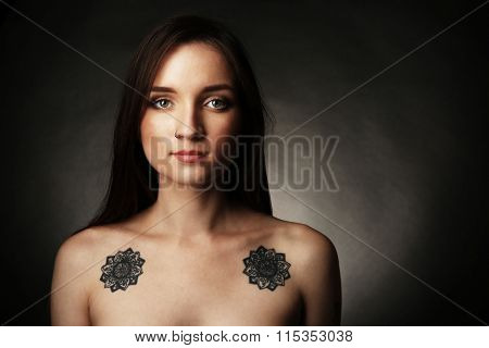 Beautiful young woman with tattoos, retro stylization