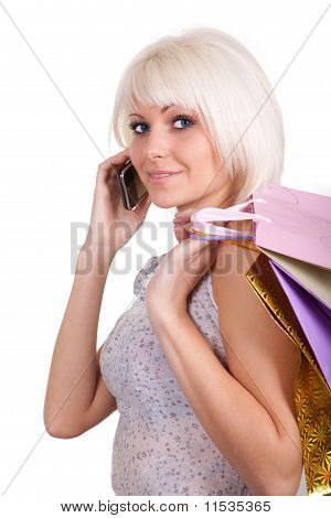 The Girl Speaks With Purchases By Phone