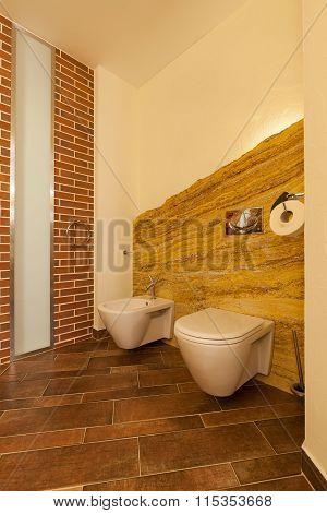 Loft Toilet In Brown Tones