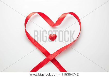 Single Red Heart Surrounded By Heart Shaped Red Ribbon