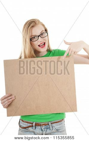 Happy Young Girl Holds Up  Empty Wooden Notice Board And Wearing Glasses On White Background.