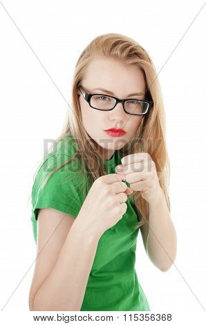 Pretty Young Girl Is Ready To Take A Hit.isolated On White.