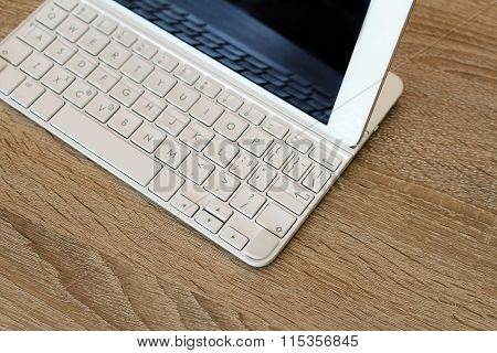 Workspace With White Tablet And Extern Keyboard