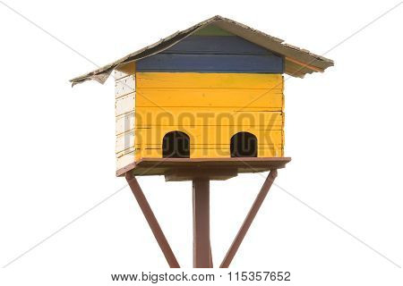 Old bird house nest isolated on white.