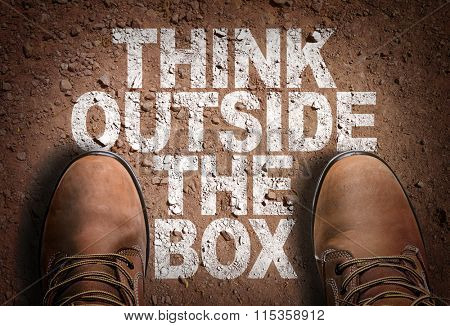 Top View of Boot on the trail with the text: Think Outside The Box