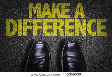 Top View of Business Shoes on the floor with the text: Make a Difference
