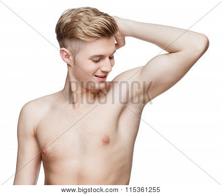 Handsome young man sniffing his armpit