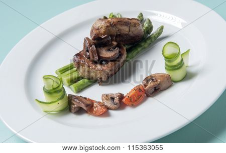 pork with brown sauce, mushrooms and asparagus in butter and lemon sauce