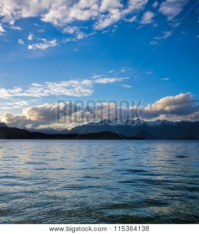 Moody sky with clouds over Lake Manapouri in the South Island of New Zealand
